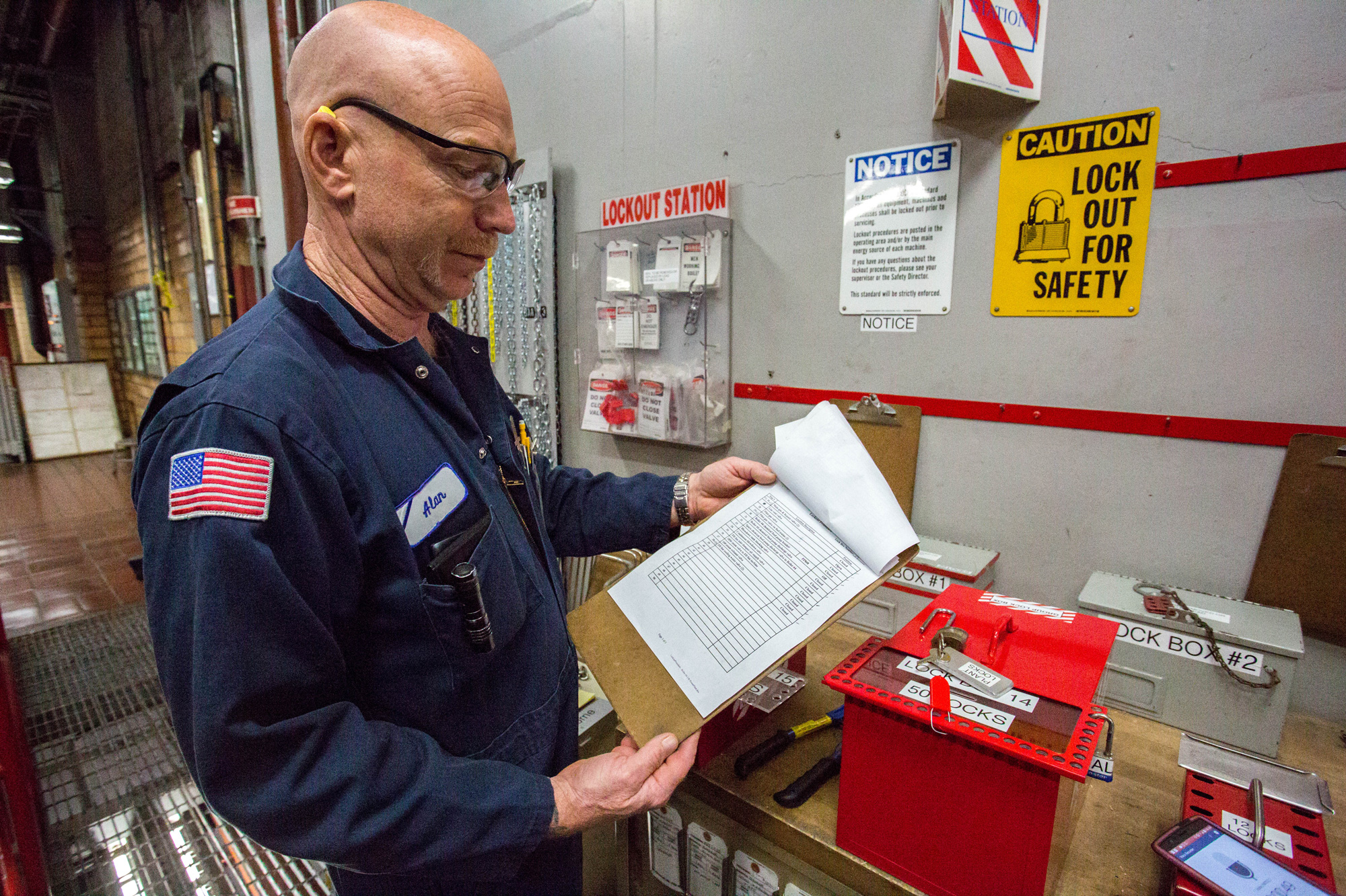 A boiler mechanic goes through the lock-out tag-out process.