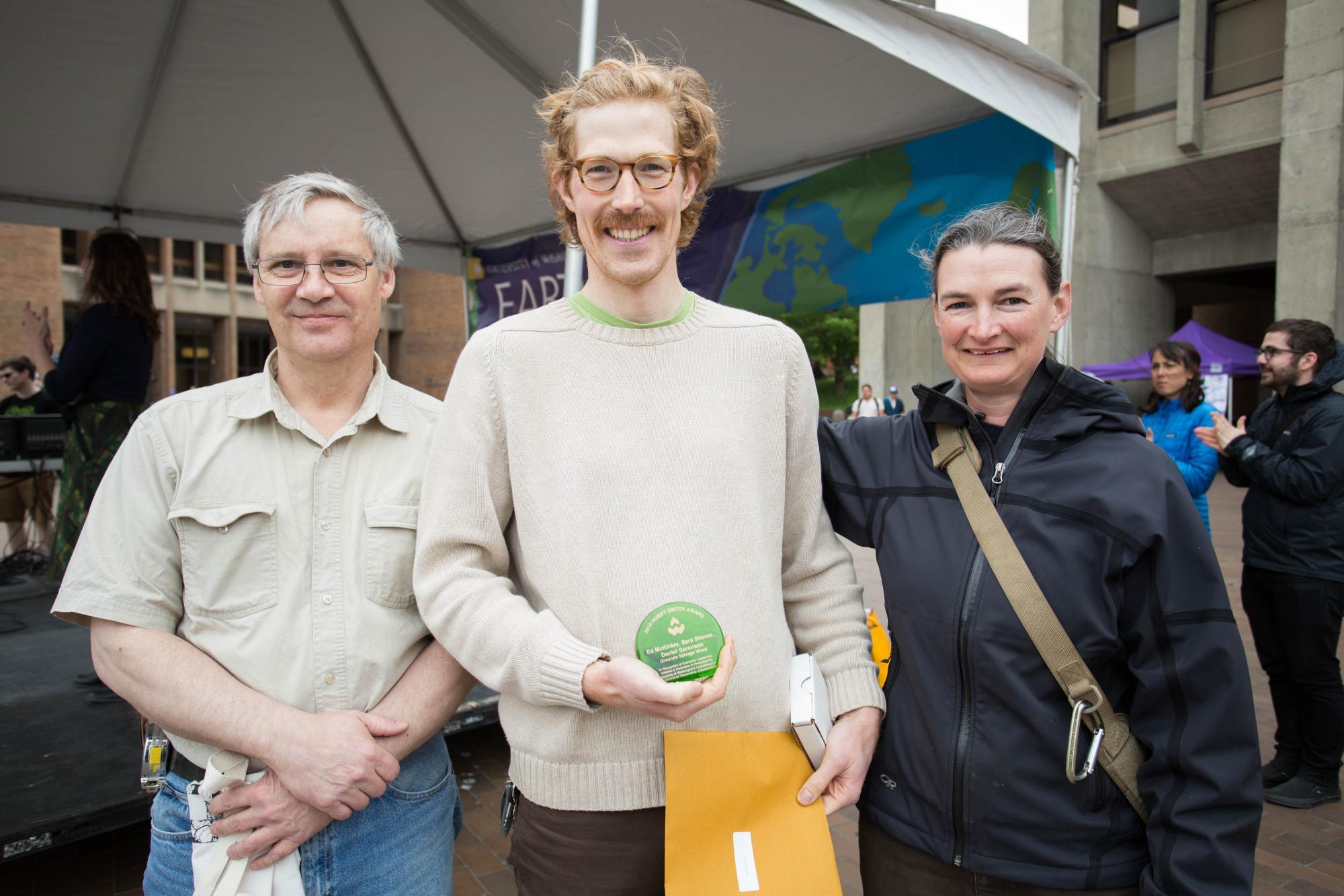 Ed McKinley, Daniel Sorensen, and Sara Shores received a Husky Green Award