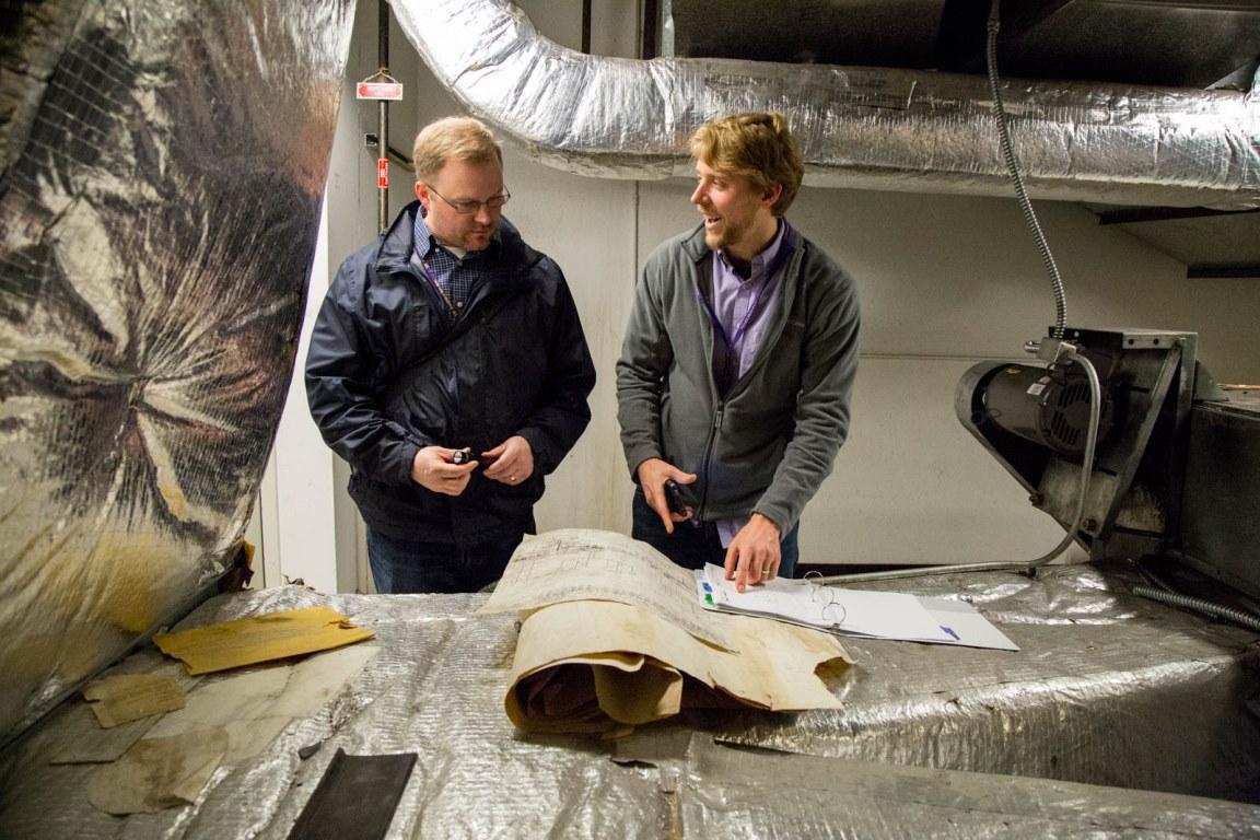 Joe Cook (left) and Erik Turner look at control drawings