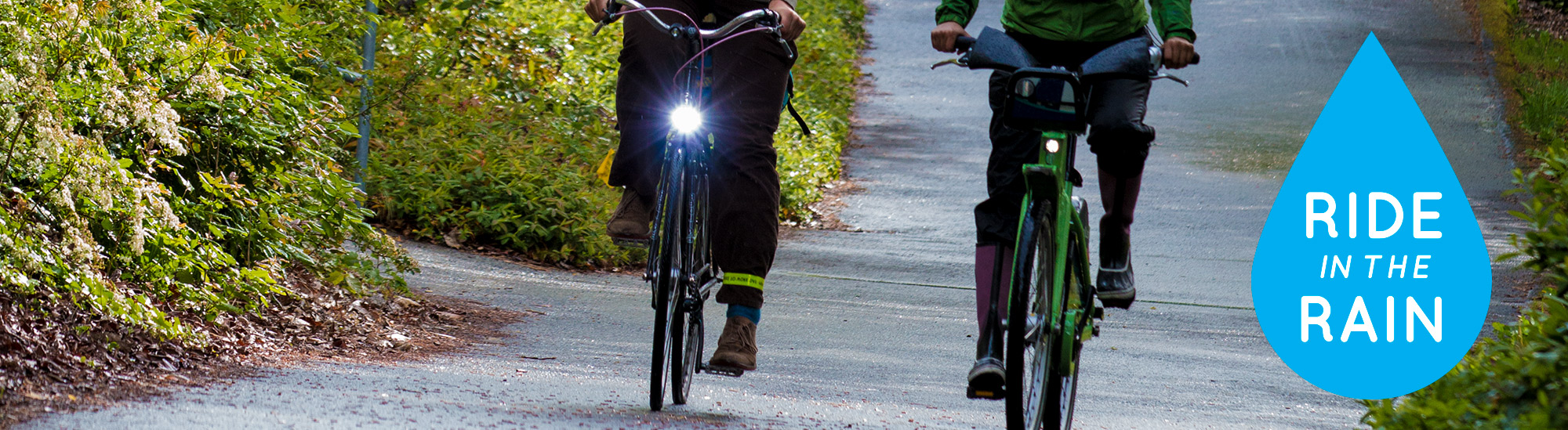 Riders on the Burke-Gilman Trail with RITR logo