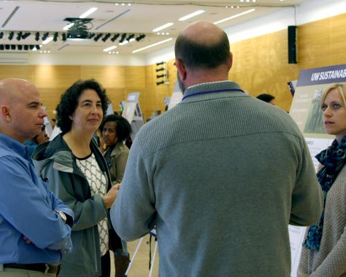 Lou Cariello, at left, listens to a Lean presentation recently in the HUB