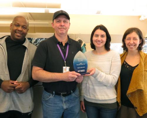 UW Recycling employees pose with their award.