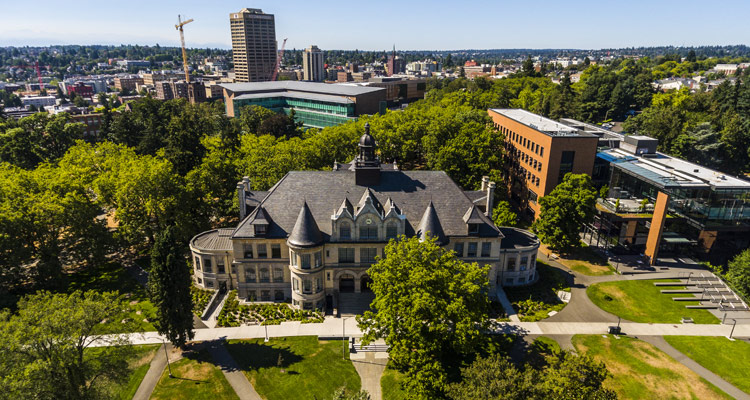 """aerial view of denny hall, paccar hall, gates hall and uw tower in background"