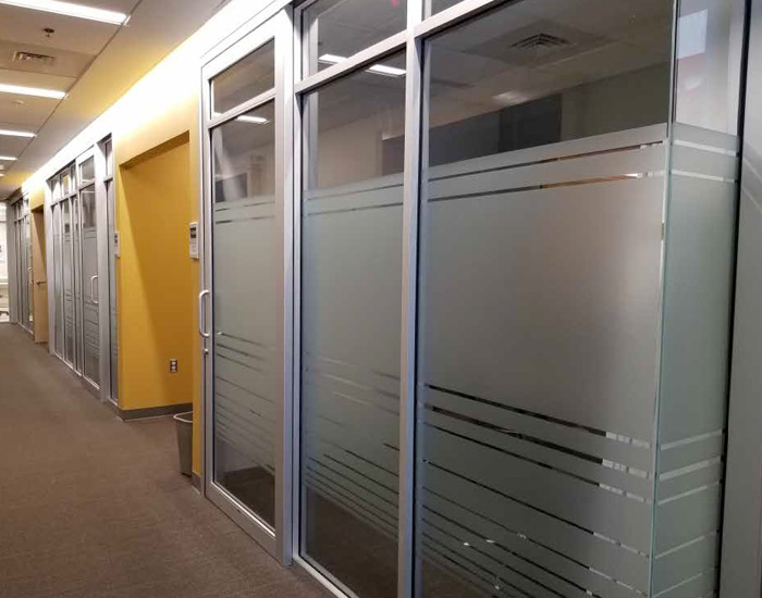 frosted privacy glass application showing office room walls of glass that is frosted