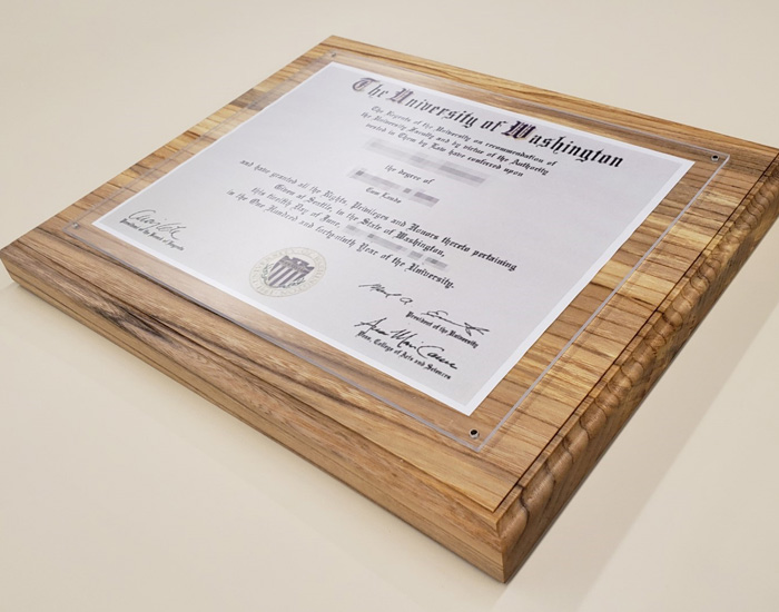wood diploma holder with UW diploma displayed