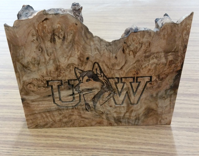 wood piece with UW and a husky engraved on it