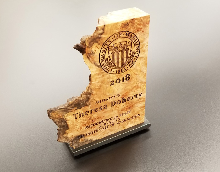 wood piece with award text engraved on surface