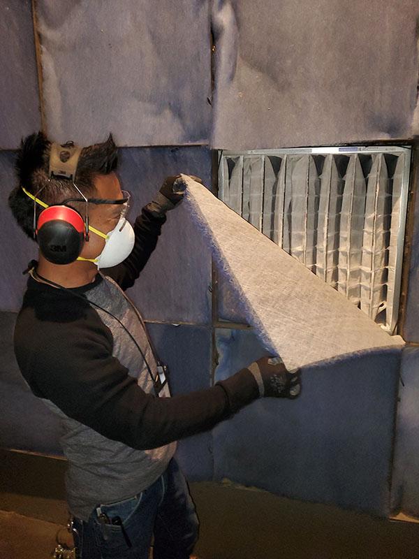 UW Facilities technician inspects a filter