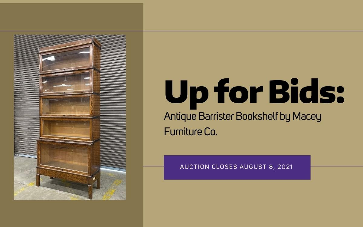 """Photo shows bookcase with glass doors. Text reads, """"Up for Bids: Antique Barrister Bookshelf by Macey Furniture Co. Auction Closes August 8, 2021"""""""