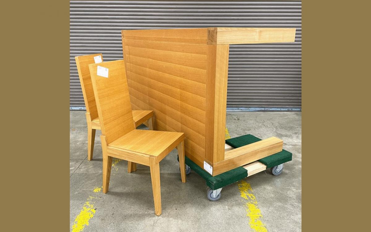 wood table with two chairs in front