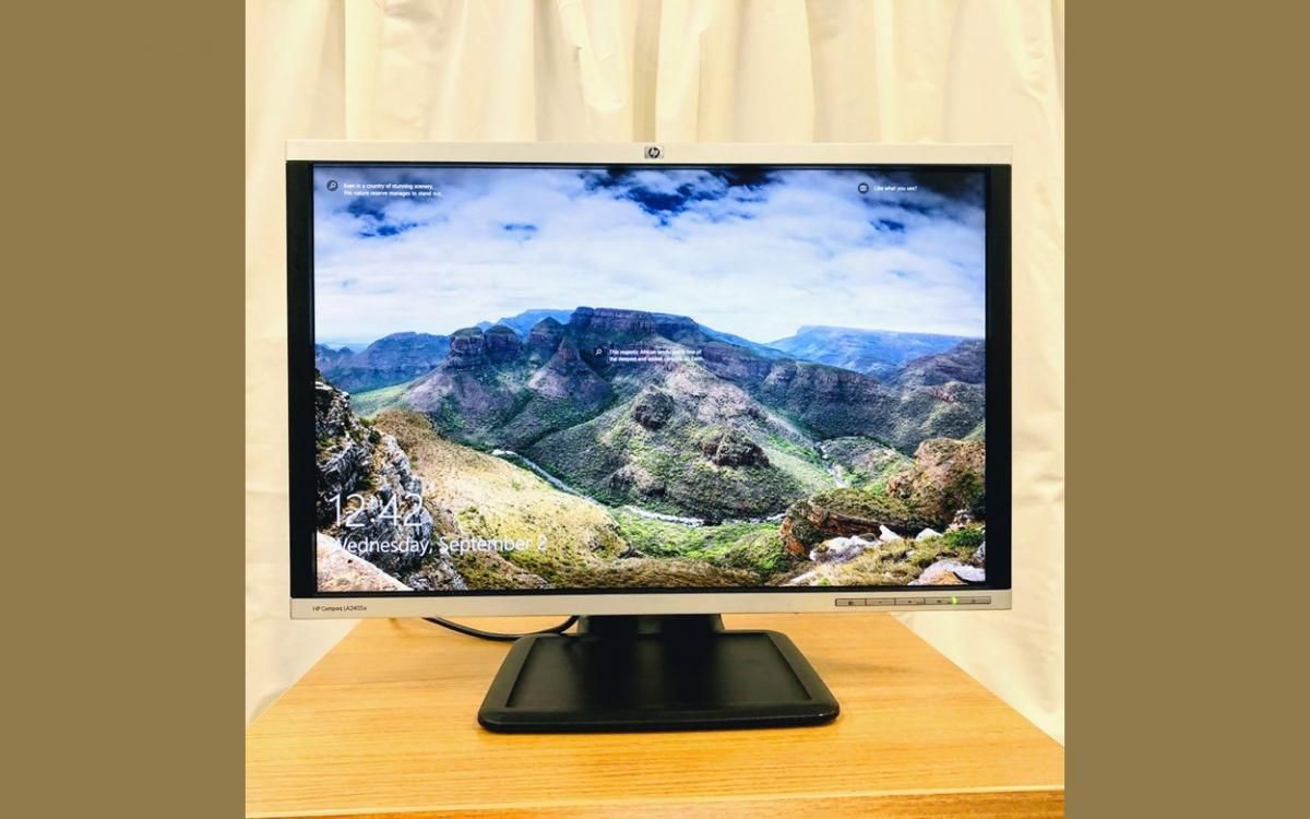 monitor on small table with curtain in background