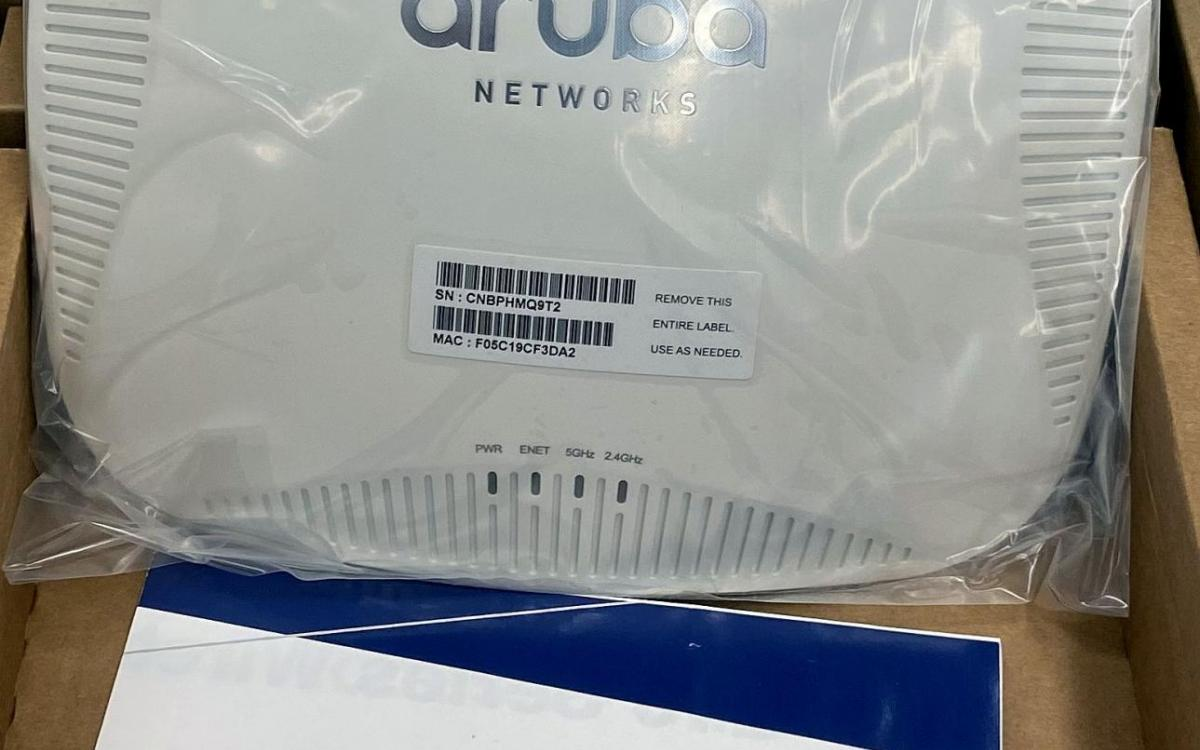 Photo of one of the Aruba wireless access points and its manual