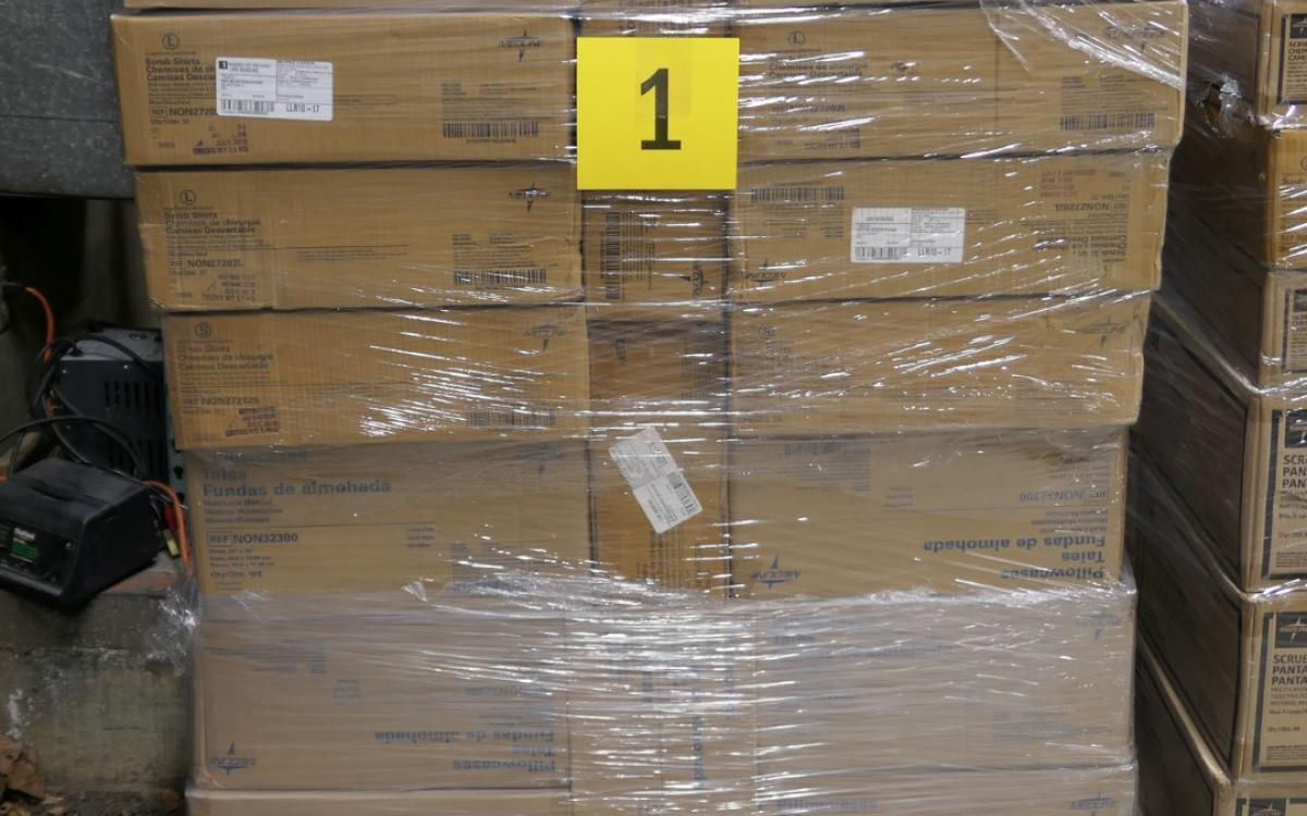 Photo of Lot 1: a pallet of disposable medical garments