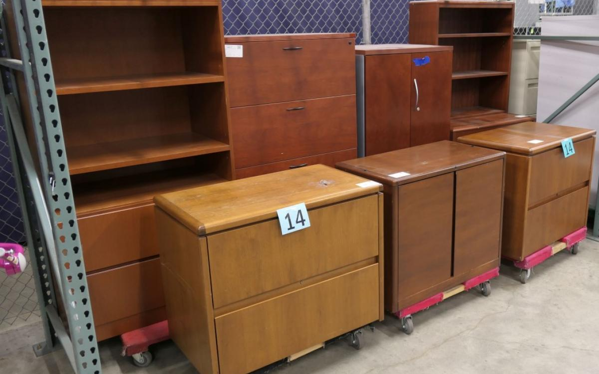 Lot 14 consists of 7 pieces of wood cabinetry and storage cases
