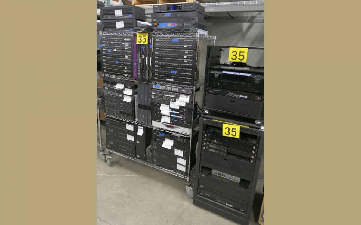 cart and two racks of assorted audio visual equipment
